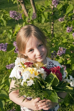 cute girl holding flowers in summer photo