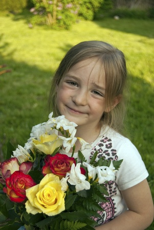 girl with flowers in the garden photo