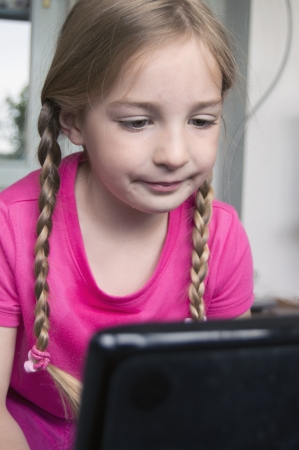 little girl learning on computer photo