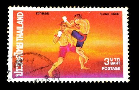 THAILAND - CIRCA 1984 A stamp printed in Thailand shows thai boxing style, circa 1984 photo