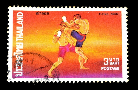 THAILAND - CIRCA 1984 A stamp printed in Thailand shows thai boxing style, circa 1984 photo