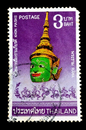 THAILAND - CIRCA JULY 1981  A postage stamp printed in Thailand shows image of traditional Thai giant mask  Khon  with the inscription  Indrajit  ;, from the series  Thai Masks, 2nd Series  circa July 1, 1981 photo