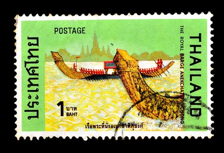 THAILAND - CIRCA NOVEBER 1975  A set of postag, jpge stamps printed in Thailand shows silhouette image figurehead of Thai royal barges, from the series  Royal Barges , circa November 18, 1975, THE ROYAL BARGE ANEKCHAT