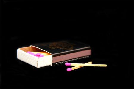 black match box with match sticks