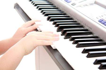 childs hands on keyboard