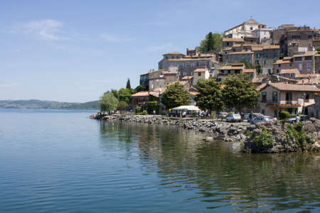 Anguillara Sabazia is a town and comune in the Province of Rome, Lazio, central Italy, around 30 km northwest of Rome. It nestles on a small cape on the coast of the Lake Bracciano; its medieval center and its beach make it a popular destination for touri