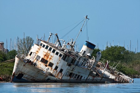 old boat: Documentary - wreck on the Tiber river, Fiumicino, Italy. Stock Photo