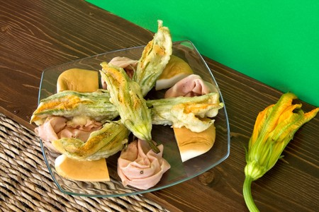 scamorza cheese: Food And Drinks - Italian Appetizers - Fried zucchini flowers with mortadella cold cut and scamorza cheese.