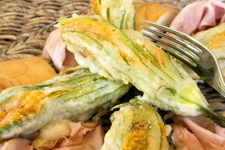 scamorza: Food And Drinks - Italian Appetizers - Closeup of plate with  fried zucchini flowers, mortadella cold cut and scamorza cheese.