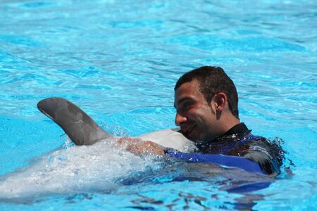 Dolphin trainer during the show at Zoomarine Park,Torvaianica, Rome, Italy, 27.05.2010. EDITORIAL USE Editorial