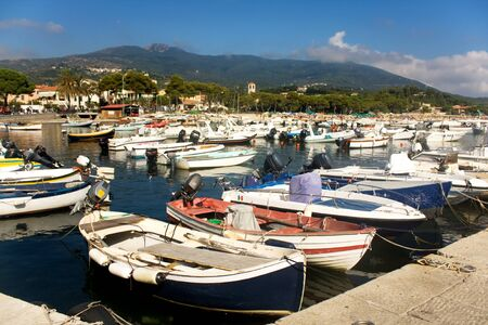 Travel - Italy. Colorful boats crowded in the small harbor of Marina Di Campo, Elba Island, Italy.
