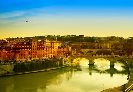 Travel Series - View of Rome and Tiber river at dusk.
