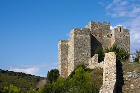 La Rocca Aldobrandesca of Telamon is an imposing fortress overlooking the homonymous coastal area of the town of Orbetello. Located on the southern promontory of Uccellina, dominates the whole coast to the Argenta promontory. Stock Photo - 7814158