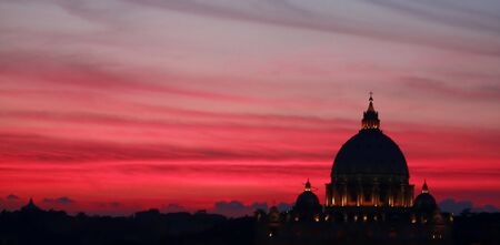 Night Photography. Silhouette shot of St. Peter's Dome in Rome.