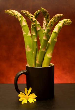 Food Ingredients - Vegetables - Cup with asparagus. photo