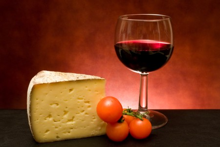 Food And Drinks - Still life with cheese and red wine.