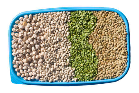 Food Ingredients - Legumes - Tray with chickpeas, black eyed peas, green peas and lentils isolated on white background. photo