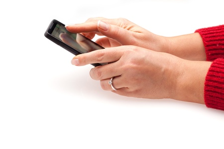 Woman hands using a smartphone, isolated on white background.