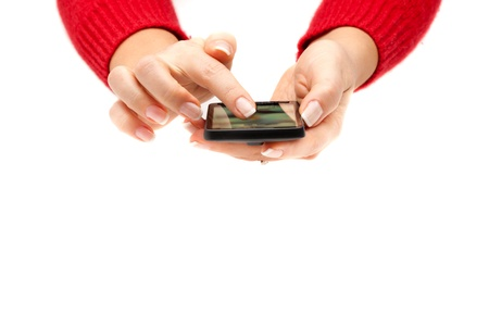 Woman hands using a smartphone, isolated on white background. Stock Photo - 8627287