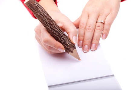 People - Actions - Woman hands with  original wood pencil ready to write something on a white piece of paper. Stock Photo - 8627314