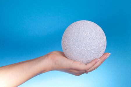Safety Concept - Hand holding a crystal sphere. Stock Photo - 8678418