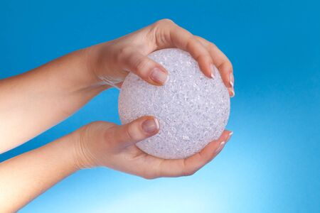 Concepts - Protection, Safety - Hands holding a crystal ball. photo