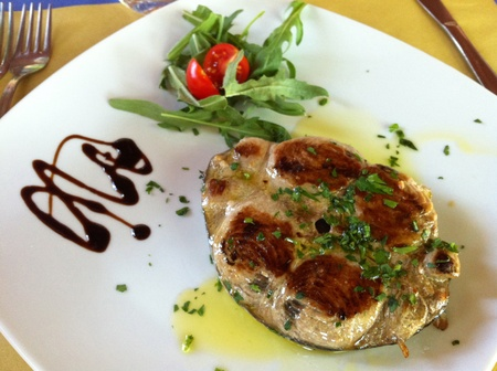 Fish plates - Plate with grilled tuna fish decorated with rocket, cherry tomatoes and balsamic vinegar. photo