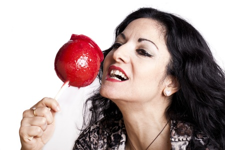 Portrait of woman with candy apple on white background. Stock Photo - 11859060