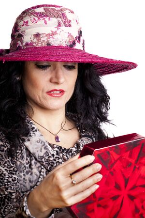 Portrait of a sexy woman opening a Christmas present. Stock Photo - 11859064