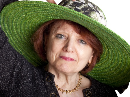 Portrait of senior woman with green hat. photo