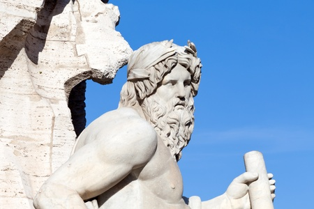 Closeup of Zeus statue made by Bernini, The Four Rivers Fountain, Navona Square, Rome, Italy