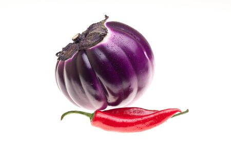 Food Ingredients - Vegetables - Round Eggplant and chili pepper isolated on white background. Stock Photo - 13189562