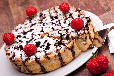International Cuisine - Desserts - Cheescake with chocolate decorated with strawberries. photo