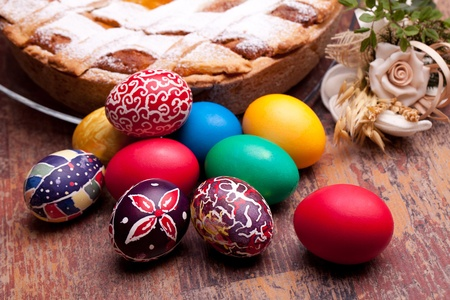International Cuisine - Desserts - Neapolitan Pastiera and colorful Easter eggs. Pastiera is a wheat and ricotta pie that is also known as Pizza Gran. photo