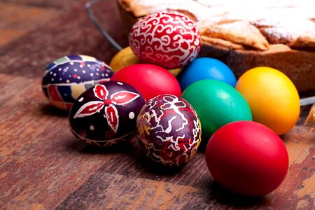 Colorful Easter eggs and plate with Neapolitan pastiera. photo