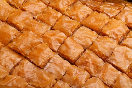 Closeup of fresh baklava cut. Baklava is a traditional sweet made in Turkey and other Middle East countries. photo