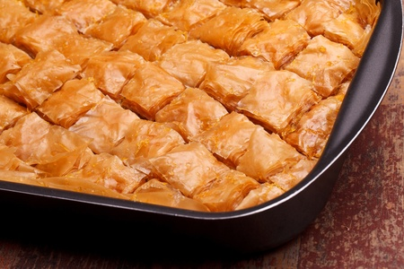 baklawa: Closeup of fresh baklava cut. Baklava is a traditional sweet made in Turkey and other Middle East countries.