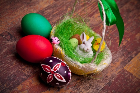 Easter eggs and  basket with candy eggs and bunny. photo