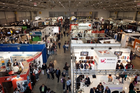 ROME, ITALY APRIL 1st: Video of people visiting stands at Photoshow, international photo and digital imaging exhibition on April 1st 2012 in Rome, Italy. Photoshow had this year an influx of 65,000 visitors in just four days. Stock Photo - 13182521