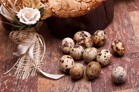 Easter still life with quail eggs and Easter dove on wood table. Stock Photo - 13354485
