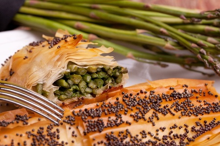 fillo: Mediterranean cuisine recipes - Asparagus in crust with poppy seeds on top and quail eggs.