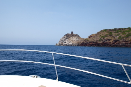 capraia: Vacations in the sea - Motorboat sailing in Tuscan Archipelago, near the coast of Capraia Island.