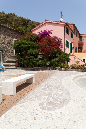 capraia: Small square with nice pavement and benches at Capraia Island, Tuscan Archipelago, Italy.