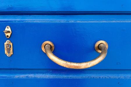 capraia: Typical mediterranean doors - Blue door with copper handle, Capraia Island, Tuscan Archipelago, Italy