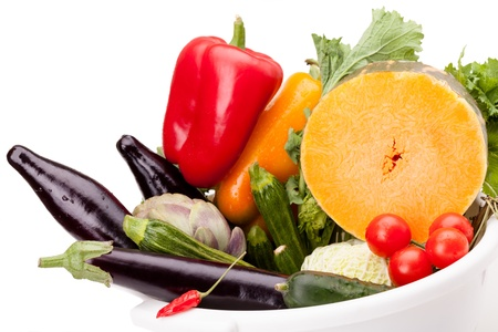 Mix of colorful fresh vegetables on white background