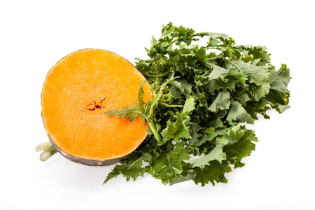 Slice of buttercup squash and bunch of broccoli rabe on white background