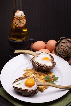 Stylish Breakfast - Creative breakfast for Valentine s day with eggs baked in artichoke half  photo