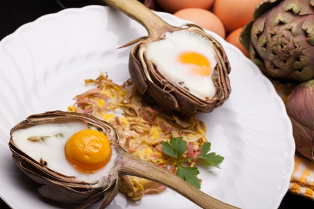Eggs In Artichokes - Creative breakfast for Valentine s day with eggs baked in artichoke half  photo