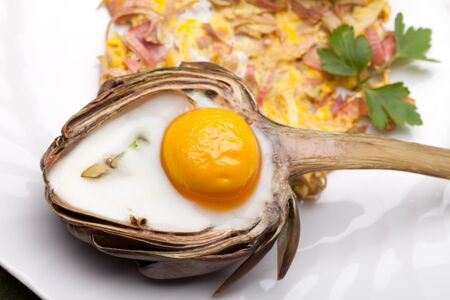 Heart Shaped Egg In Artichoke - Creative breakfast for Valentine s day with egg baked in artichoke half  photo
