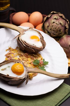 Easter Eggs In Artichokes - Creative Easter meal with eggs baked in artichokes halves  photo